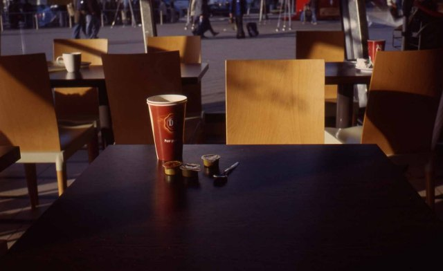 Netherlands. Amsterdam Schipol. Early morning, Duane Egbert coffee. Flight commuters background